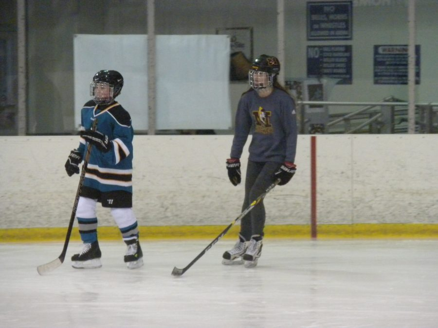 Junior+Elena+Ervin+skates+next+to+a+MORC+Star+player+during+the+learn-to-skate+session.+%28Photo+Credit%3A+Shannon+Seabolt%29