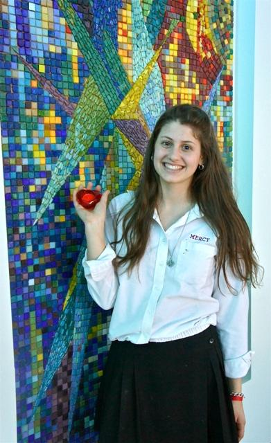 Teresa Rotondo proudly displays a gift she received after being named the Heart of Mercy.