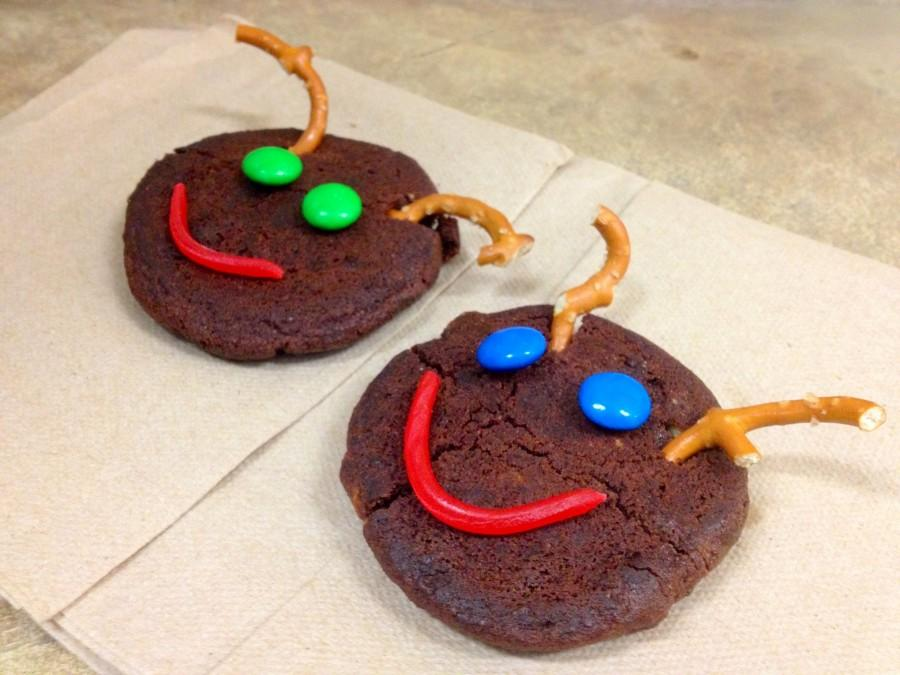 Composed of simply a chocolate cookie, pretzels for the antlers, M&Ms for the eyes, and a Twizler