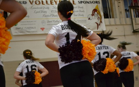 Husaynu (center) performs with the Mercy Pompon team.