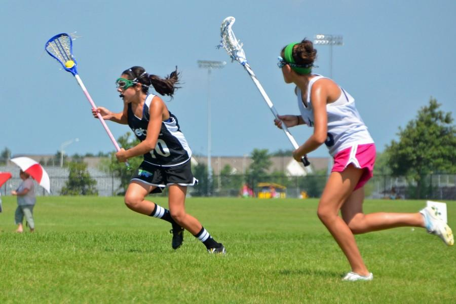 Sophomore Brooke Ottaway speeds past a defender in a tournament for the Detroit Coyotes. Photo credit: Liz Ottaway