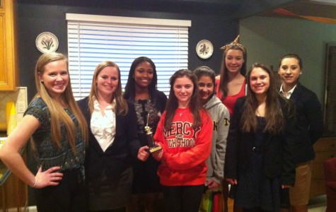 Mercy's Mock Trial team shows off their Honorable Mention trophy after their regional competition.  Photo Credit: Ann Winn