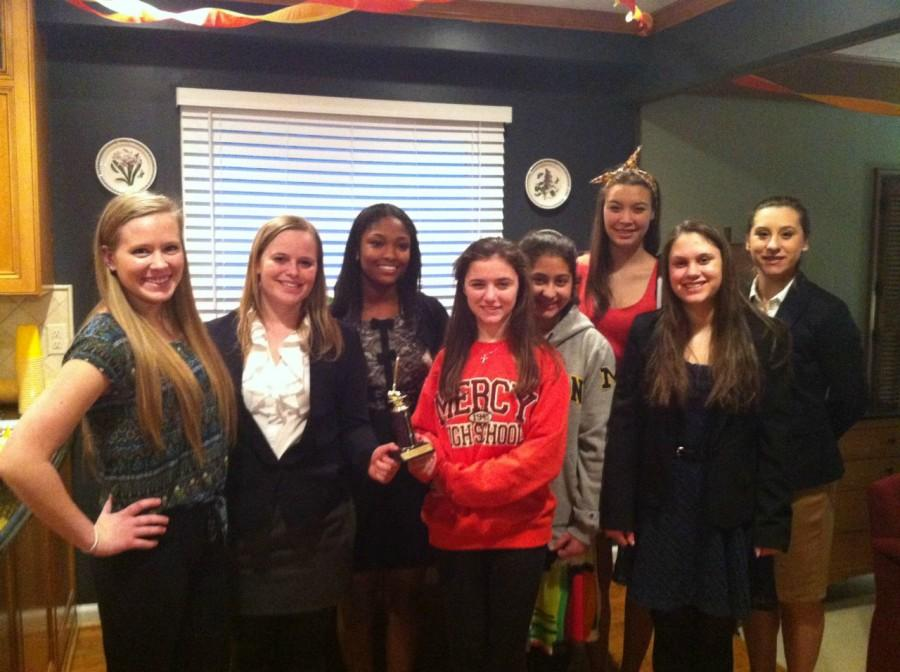 Mercy%27s+Mock+Trial+team+shows+off+their+Honorable+Mention+trophy+after+their+regional+competition.++Photo+Credit%3A+Ann+Winn