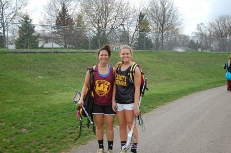 Varsity lacrosse players, junior Tori Sullivan (left) and senior Allie Shaw, grin after an exhausting practice. Photo credit: Anjali