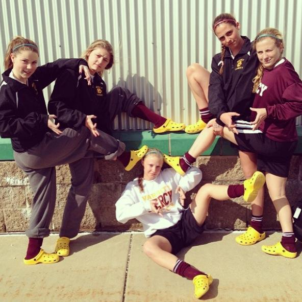 Mercy Varisty Soccer sports their crocs before a game.  Photo Credit: Mia Perelli