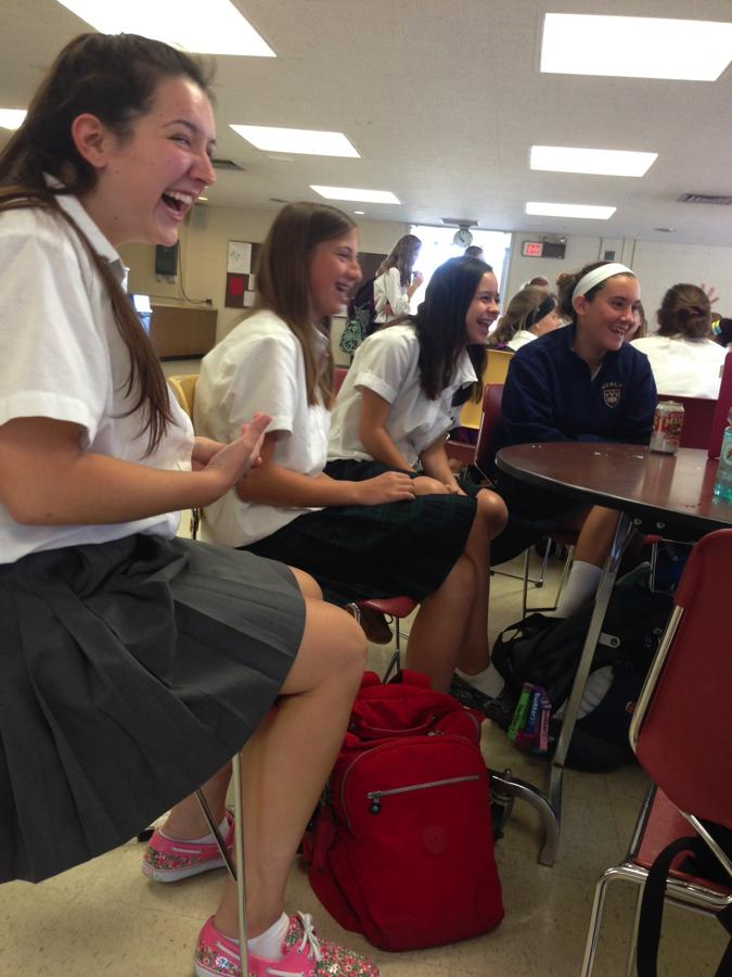 Senior+Natalie+Lewandowski+shares+a+laugh+with+friends+she+made+in+her+freshmen+Gym+Swim+class.