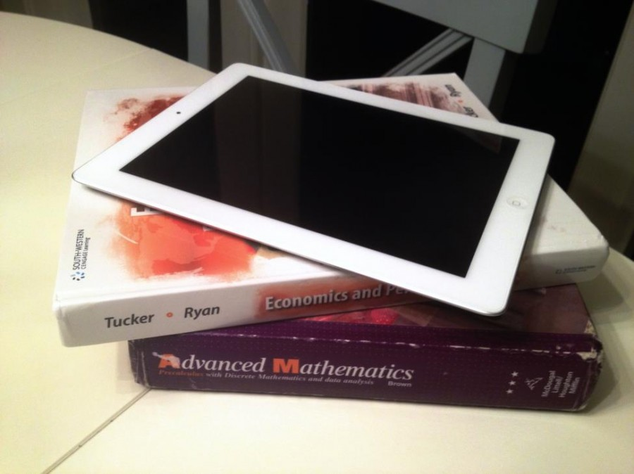 While+e-books+on+iPads+lessen+the+weight+compared+to+clunky+textbooks%2C+they+come+with+mixed+opinions+from+many.+