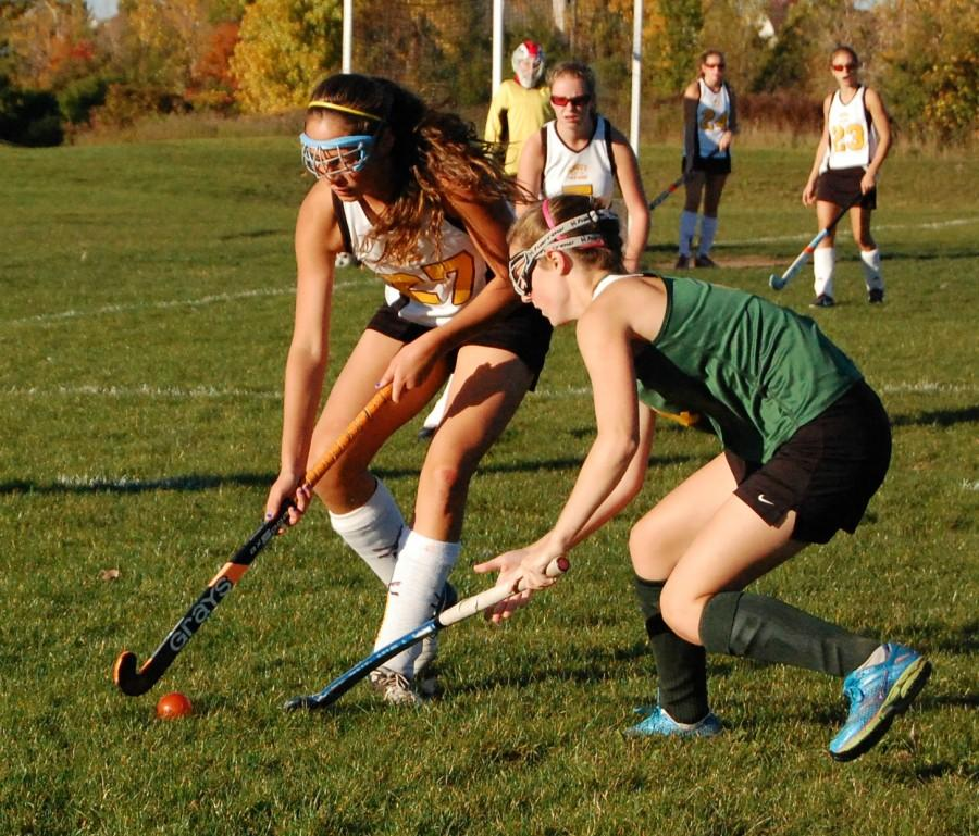 Junior, Maria Pulice, battles to get the ball away from Huron so they do not score a goal.