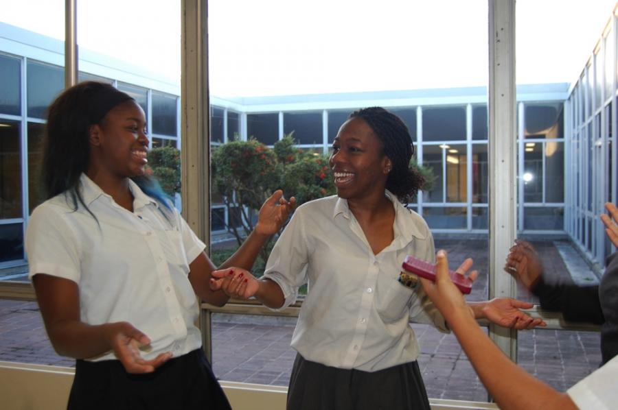 Nneka Iroha converses with her cousin, junior Ogechi Nwaopara.