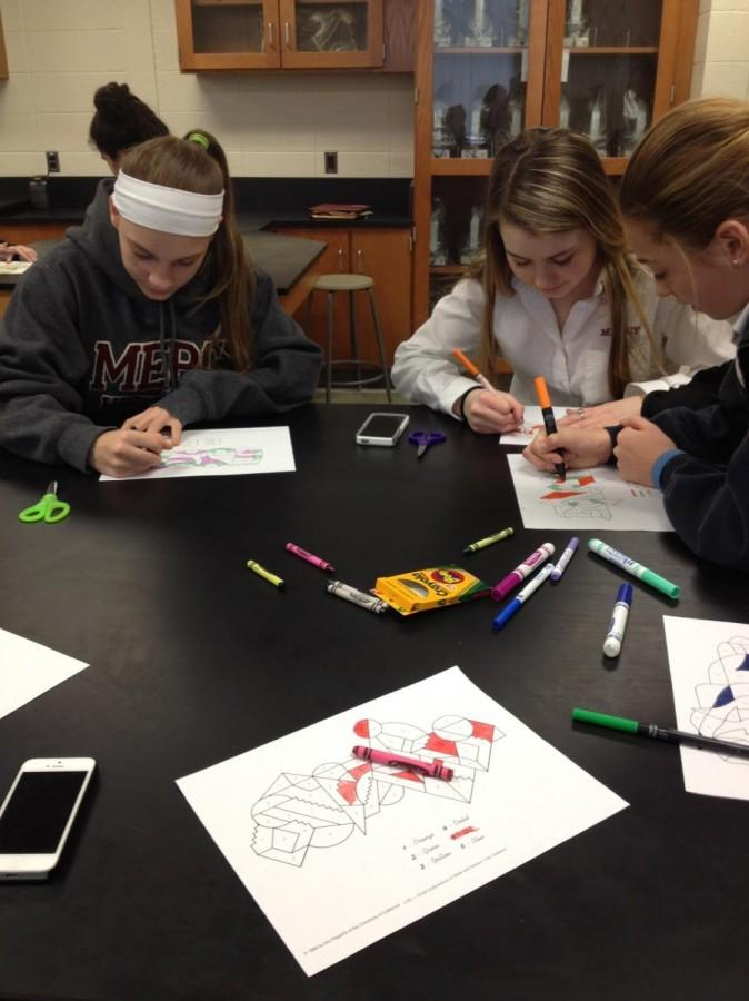 Students color drawings with markers at the most recent Science Club meeting.  Photo Credit: Hannah Hembree