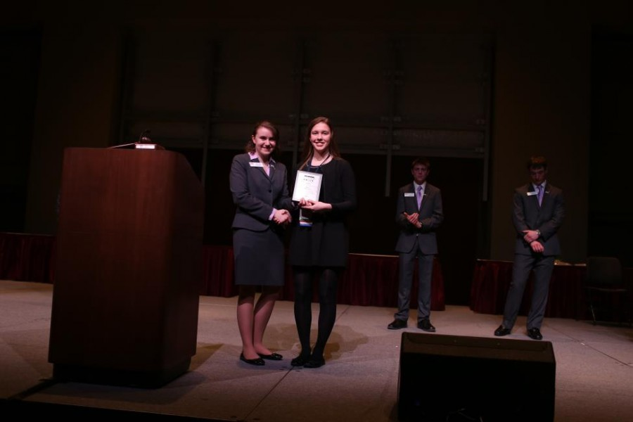 Claire+Lachner+%28right%29%2C+Mercy%27s+BPA+president%2C+smiles+with+state+president%2C+Megan+Tack%2C+as+she+accepts+the+Chapter+Membership+Increase+award+on+behalf+of+the+Mercy+BPA+chapter.+