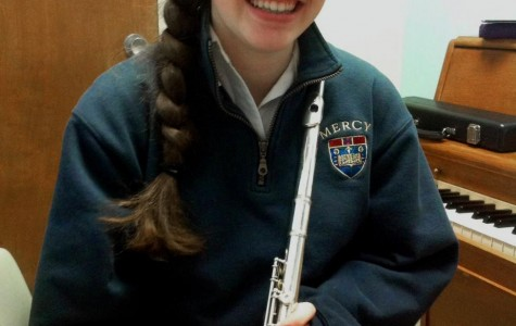 Elise Scarchilli is immersed in music; she plays flute in Mercy's orchestra and in the Royal Oak High School marching band, competes in music festivals, and is an avid pianist.