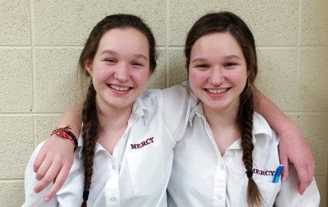 Twins CJ and Katie Dillon stand side by side.