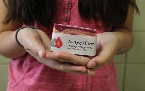 Hakim, 14, makes a large variety of soaps and candles which alternate with the seasons (Photo Credit: Theresa Benton).