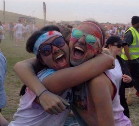 "Although junior Hannah Lesko (left) takes competitive running very seriously, she enjoys participating in runs designed for fun, such as the Color Me Rad race in Detroit, which she completed with her friend Lauryn Hauncher (right) this past summer. ""Fun runs make running more of a social event,"" said Lesko. ""It is good for me to take a break from the super intense runs every once in a while"" (Photo Credit: Allia McDowell)."