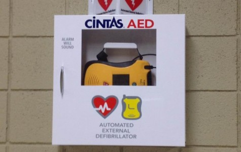 Mercy's brand new AEDs hang in five places around the school.  This one is placed near the reception area (Photo Credit: Katie Birecki).