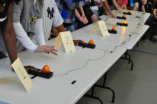 At a quiz bowl tournament, the students must ready themselves to answer questions with their hands poised above the buzzer. (Photo permission from Creative Commons Flickr. Photo Credit: Karen Blumberg).