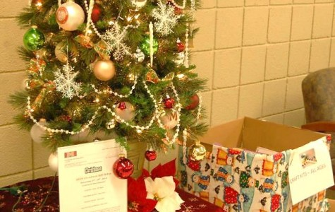 The Christmas Gift Drive ends Dec. 8 at noon when organizations arrive to pack the gifts under the Reception Area Christmas tree (Photo Credit: Theresa Walle).