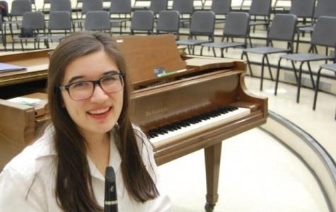 Senior Sarah Hughes joined Mercy's symphony orchestra as a senior (Photo Credit: Theresa Walle).