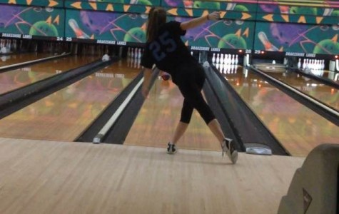 Junior Heather Lillystone perfects her form during bowling practices at Drakeshire Lanes, two to three times a week (Photo Credit: Lilly Blake).