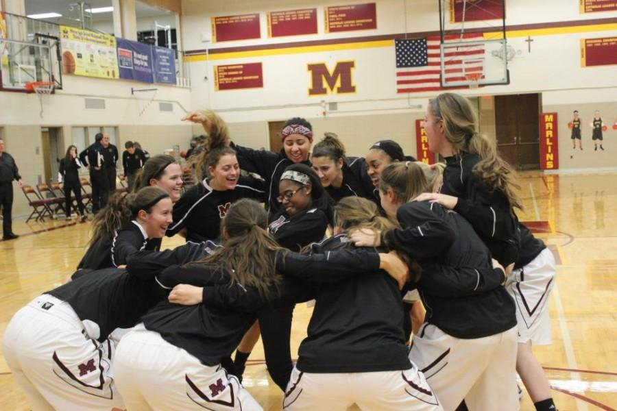 Mercy varsity basketball gets motivated for their home game against their longtime rival, the Ladywood Blazers (Photo Credit: Peyton Pawlusiak).