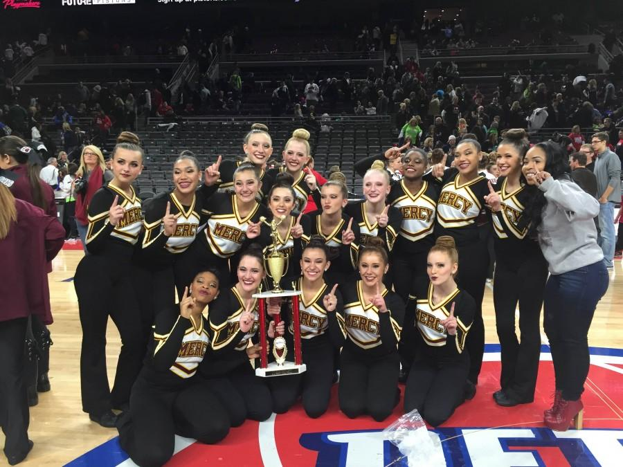 The+Mercy+Pompon+team+poses+with+their+first+place+trophy+at+the+Palace+of+Auburn+Hills+Pompon+Competition+on+Jan.+17+%28Photo+Courtesy%3A+Larry+Baker%29.+