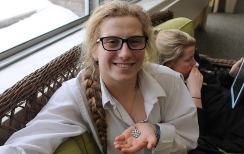 Senior Taylor Babcock holds her Kairos cross as a reminder of her meaningful experience attending and leading the Kairos retreat (Photo Credit: Emma Mallon).
