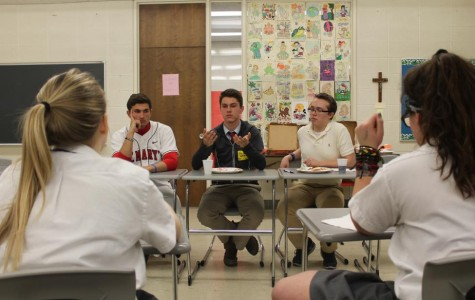 Students Billy Gischa, Harrison Coe, Steve Lansky, and Ryan Doyle shared their opinions on various pro-life topics at this year's boy panel (Photo Credit: Emma Mallon).