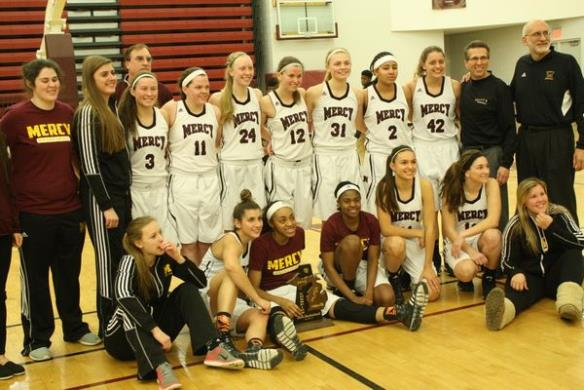 Mercy clinched the district title, beating Detroit Mumford 60-43. (Photo Credit: Photo Courtesy of Mike Moore, C&G News)