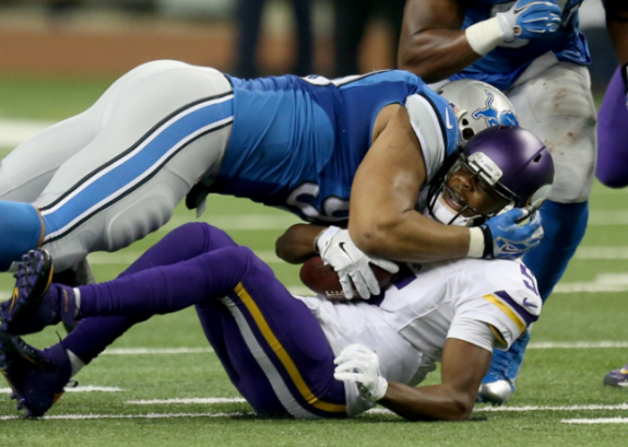 Ndamukong Suh sacks Minnesota Vikings quarterback Teddy Bridgewater on Dec. 14, 2014 at Ford Field in Detroit. (Photo Credit: MCT Wire Service).