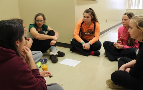 Students discuss personal pro-life experiences with club leaders Cari Padula and Natalie Cieslak  (Photo credit: Emma Mallon).