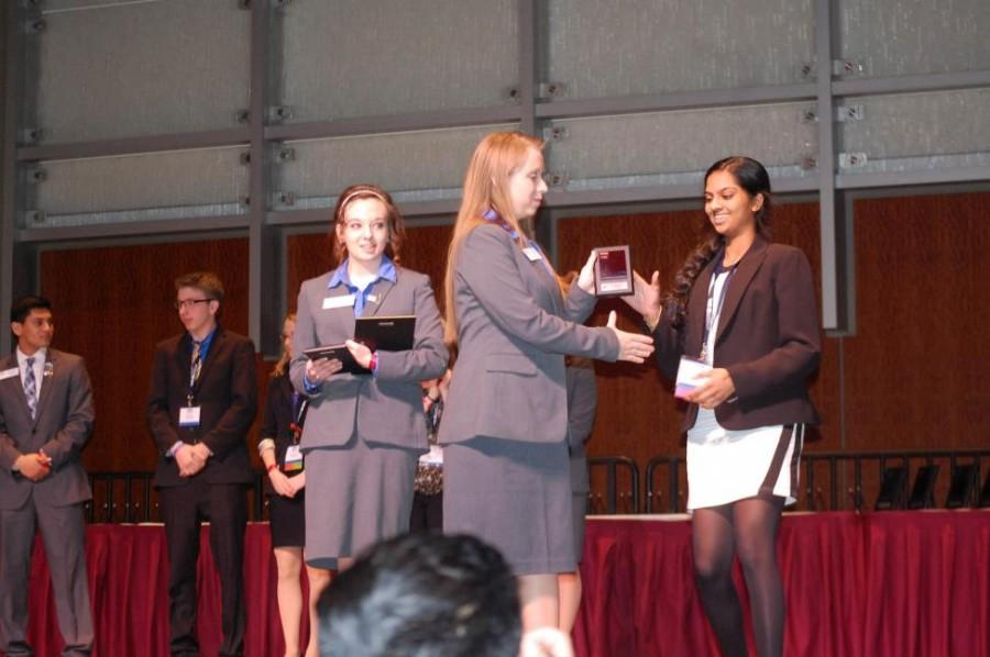 Sophomore Saveri Nandigama accepts her award at the BPA State Conference in March (Photo credit:  Ms. Hallie Smith).
