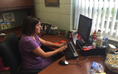 Lindsay Weismiller, Mercy's special events coordinator, works hard on her computer to prepare for the 70th Anniversary Grand Reunion.