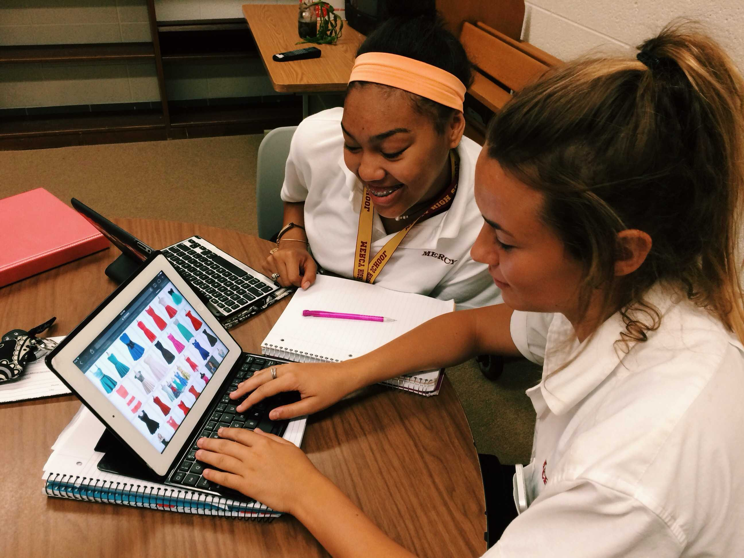 Juniors Gianna Parlove and Addie Powell take time out of their busy day to online shop for homecoming dresses.