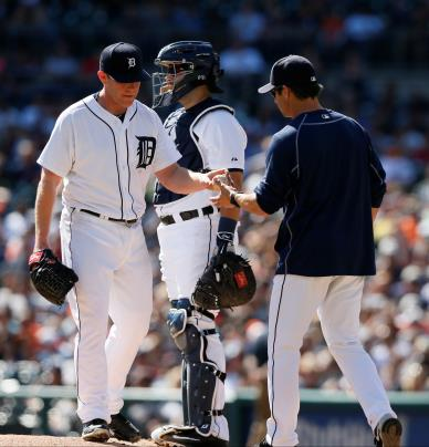 Pitcher Randy Wolf gives manager Brad Ausmus the ball during a home game against the Minnesota Twins. The Detroit Tigers close their season on Sunday, Oct. 4 against the Chicago White Sox. (Photo credit: Julian H. Gonzalez)