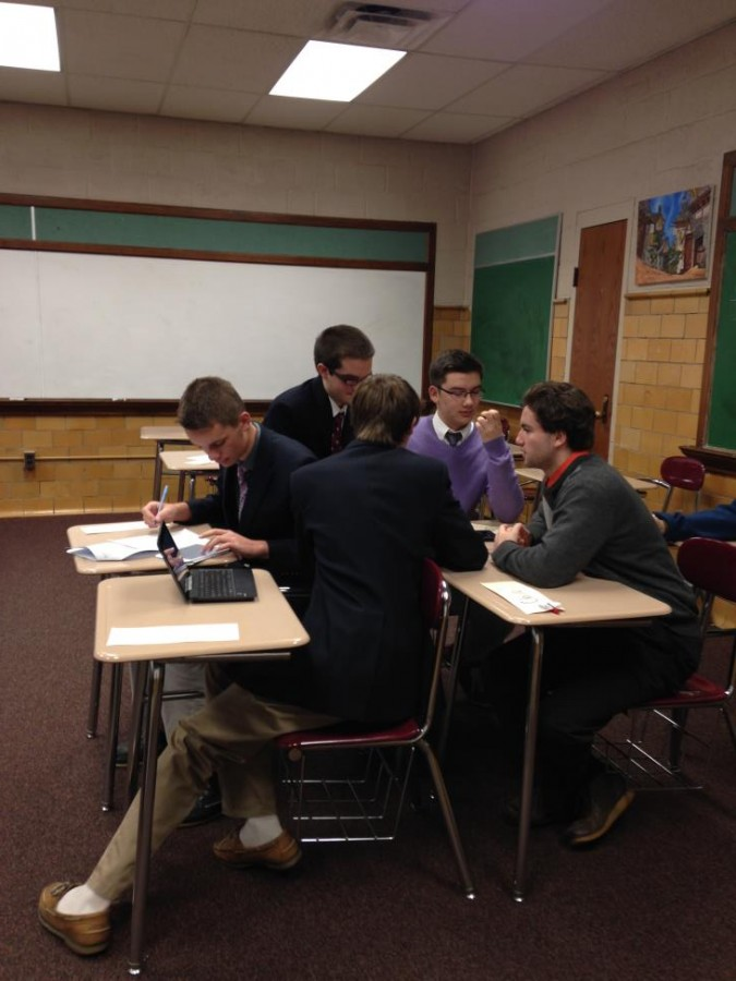 An alliance of countries huddle together to discuss its next move during a MUN crisis.  (Photo courtesy of Carmela Sleva)