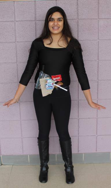 Mercy Cafeteria Table: All you need is an all-black outfit, a bunch of trash, and tape. You will look the part in no time. Model: Isha Ganguli (Photo credit: Jasmine Williams)