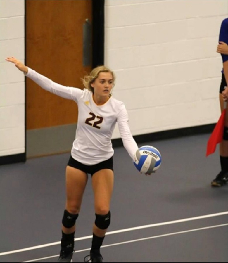 "Senior Sloan Horejsi (#22) has played volleyball since the fourth grade. ""It is weird being a senior and being a leader… I was so used to turning to my seniors in the past years so it was a big role change… However, it was also a natural feeling because you just know what to and you lead the team without even realizing it."" (Photo courtesy of the Mercy Varsity Volleyball team)"