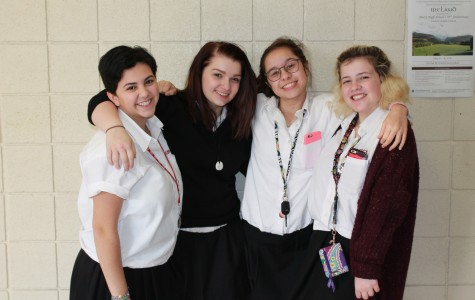 Junior FEM club leaders Maria Pizzo, Clare Brees-Oswald, Claire Alafita, and Brooklyn Rue spend an off hour together discussing plans for the club. (Photo credit: Helena Tomkiw)