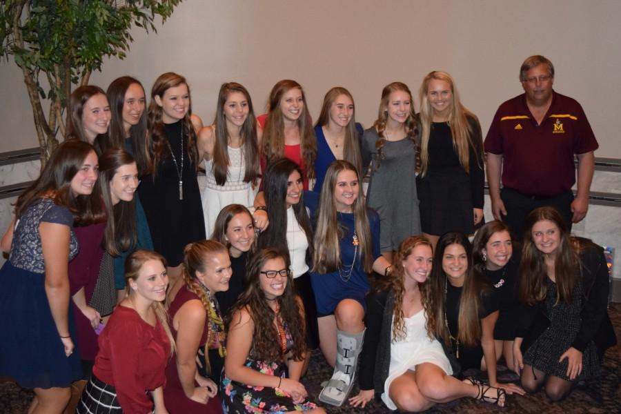 The Mercy Varsity Field Hockey team members smile at their banquet on Nov. 1, where they remembered and celebrated their successful season and friendship. (Photo credit: Erin Lyons)