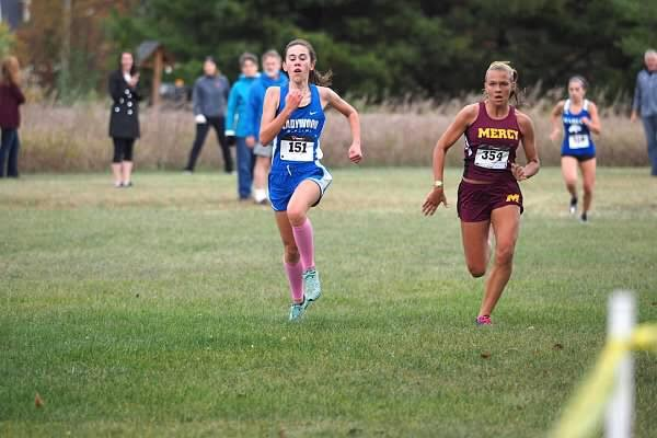 A+rush++of+adrenaline+helps+sophomore+Sophie+Lamphier%2C+left%2C+strongly+finish+the+last+200+meters+of+the+race.%0A%28Photo+courtesy+of+the+Mercy+Cross+Country+team%29++