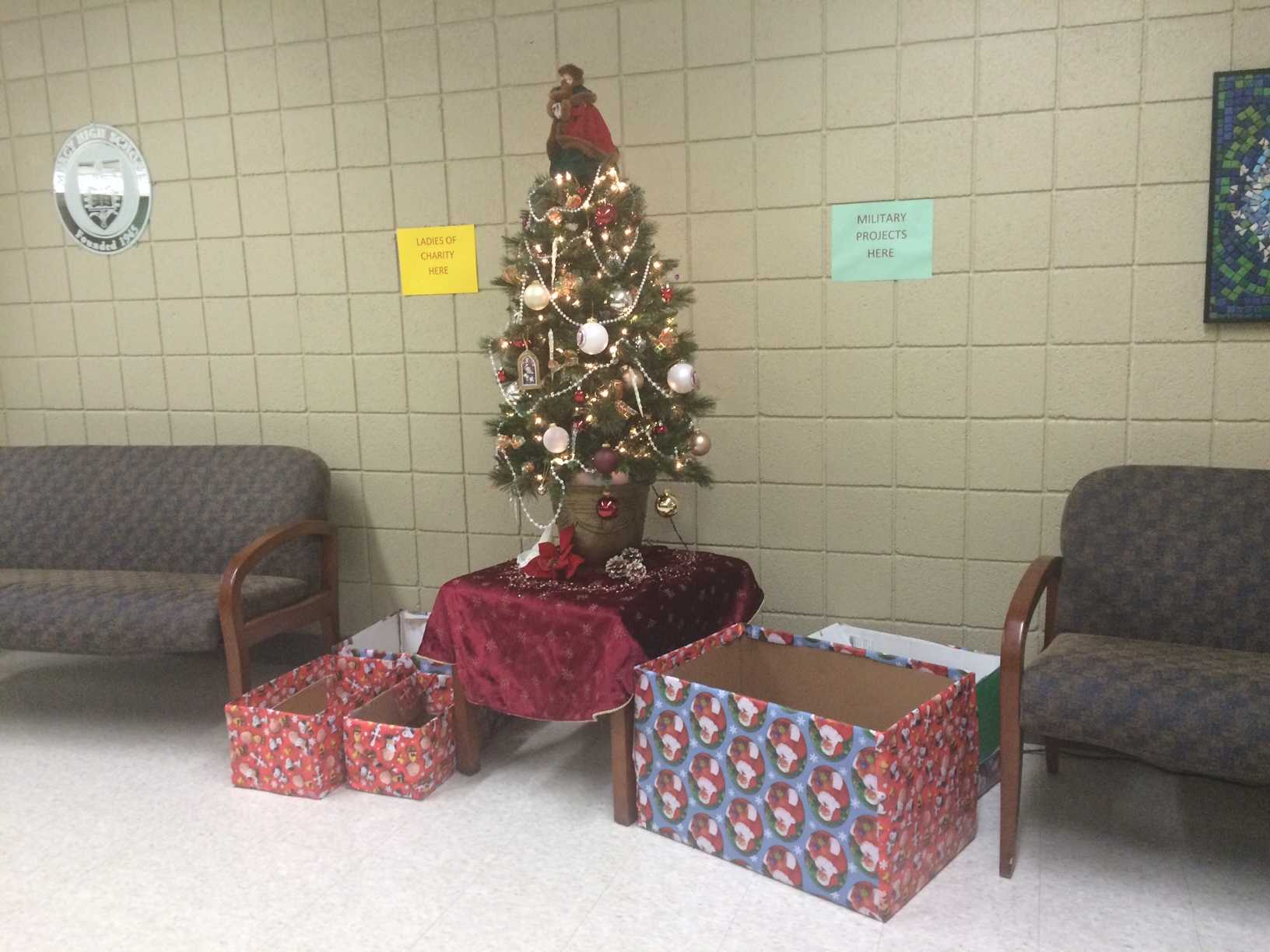 Donations for soldiers are being collected under the Christmas tree until Dec. 8. (Photo credit: Chanel Taylor)