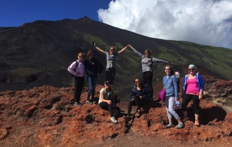 Senior Marisa Hardenbergh poses with members of Mercy's Latin program along Mount Etna in July 2015, before any sign of the volcano's latest explosion. (Photo courtesy of Marisa Hardenbergh)