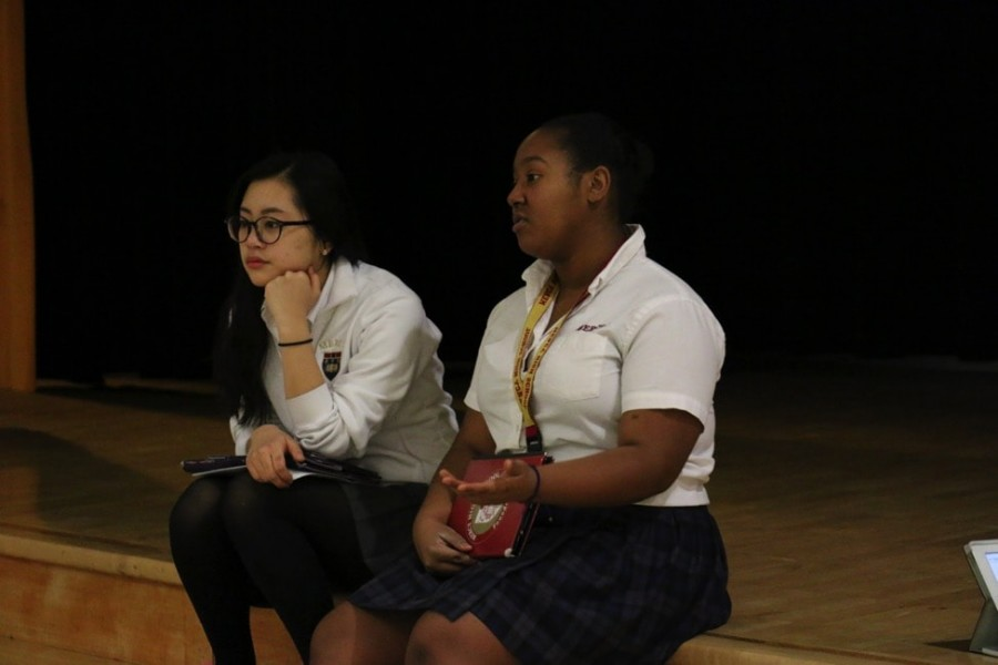 Senior Blair Cha and Junior Indya Hood led HRC's forum on Tuesday about unity among the girls of Mercy. (Photo credit: Paisley Sutton)