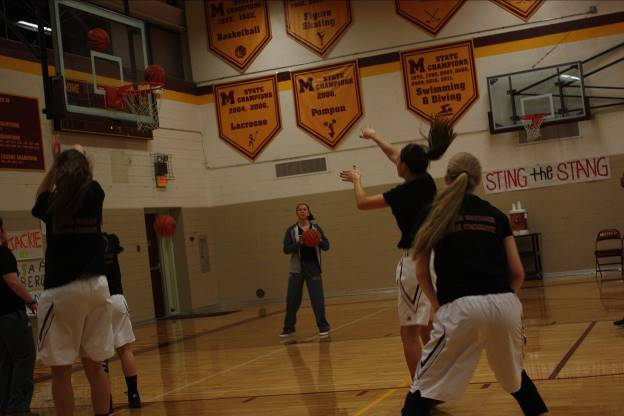 After being honored at Senior Night, senior Lauryn Hauncher shoots a basket in preparation for her last Catholic League game on MVB. (Photo credit: Sydney Hughes)