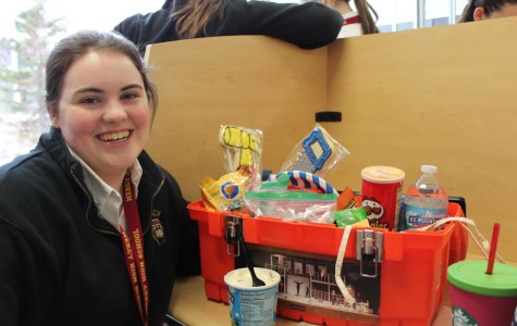 Junior Megan McCarren is all smiles after receiving her lucky lunch from Ms. Eddy. (Photo credit: Caitlin Somerville)