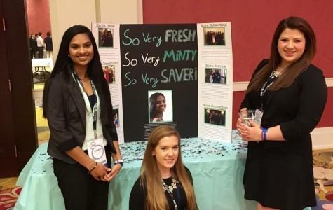 Juniors Katelynn Smith and Bridgett Eusebi help Saveri Nandigama campaign for a spot on the BPA State Council. (Photo courtesy of Saveri Nandigama)