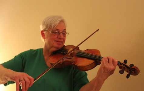 Mrs. Marianne Corrigan plays her favorite violin which she has had for over 20 years.