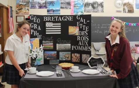 Sophomores Grace Denomme and Mary Doman present their gallette aux rois des pommes in Madame Campbell's room. (Photo credit: Alana Sullivan)