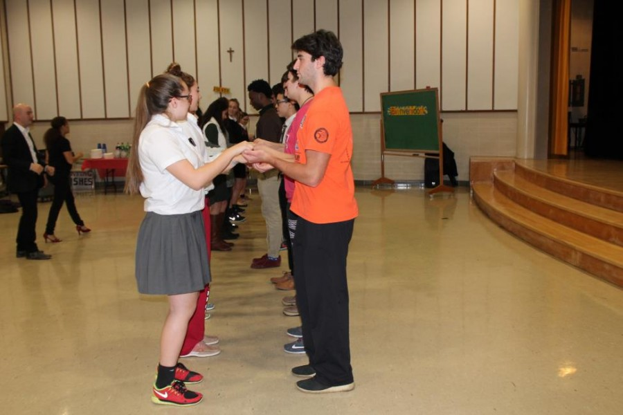 Students line with their partners as they learn the basics of salsa dancing. (Photo credit: Sydney Hughes)